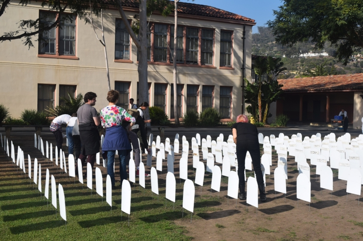 SBHS students setting up cemetery display representing youth killed in action