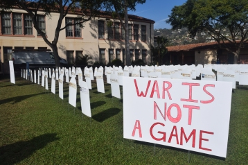 """War is Not a Game"" cemetery display representing youth killed in action"